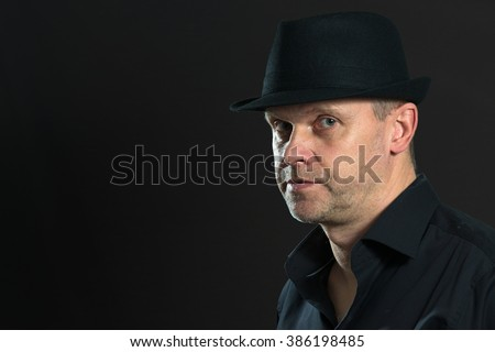man with black hat - stock photo