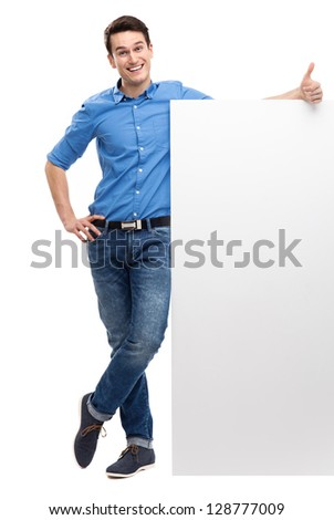 Man with blank poster showing thumbs up - stock photo