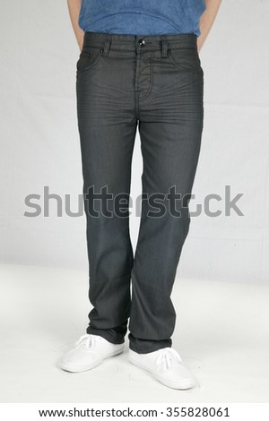 man with blue jeans and white shoes