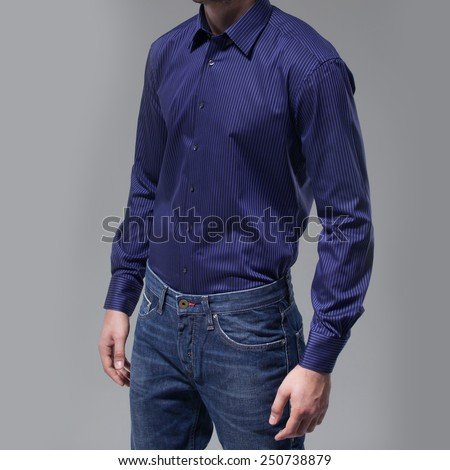 Man with blue shirt over dark background - stock photo