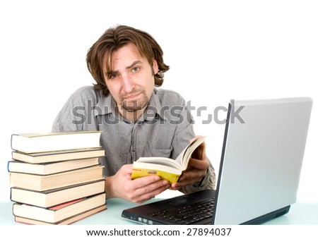 man with books and laptop