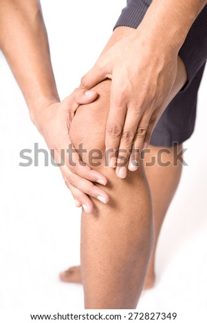 Man with both palm around knee cap to show pain and injury on knee area. - stock photo