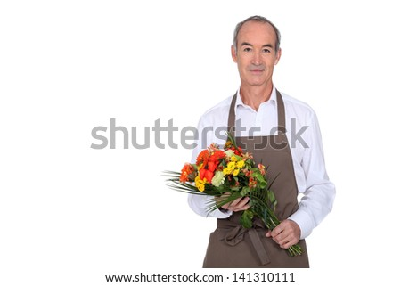 Man with bouquet of flowers - stock photo