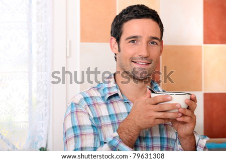 Man with bowl of cereal - stock photo