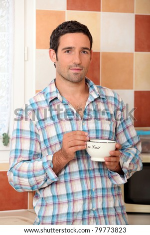 Man with bowl of hot chocolate - stock photo