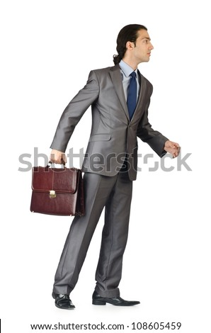 Man with briefcase on white - stock photo