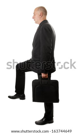 Man with briefcase strides