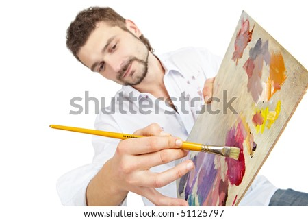 Man with brush and palette. Shallow depth-of-field. Isolated over white - stock photo