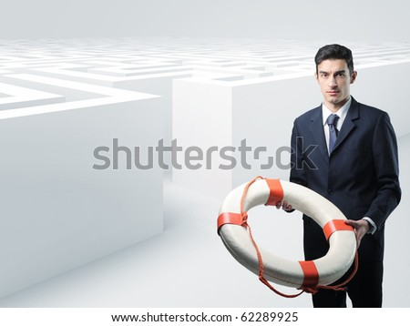 man with buoy and 3d maze background - stock photo