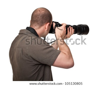 man with camera and huge lens - stock photo