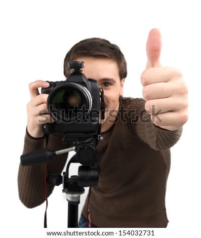 Man with camera. Cheerful young man holding camera and gesturing while standing isolated on white - stock photo