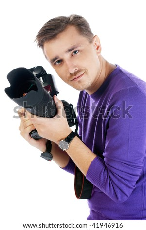 Man with camera posing isolated on the white background - stock photo