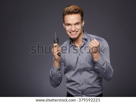 Man with Car Keys and Thumbs Up - stock photo