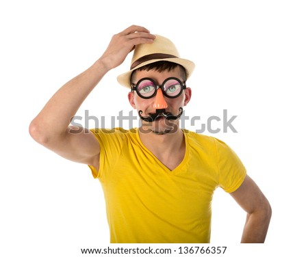 Man with carnival mask and hat isolated over white