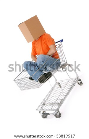 Man with carton box on head sitting in shopping cart