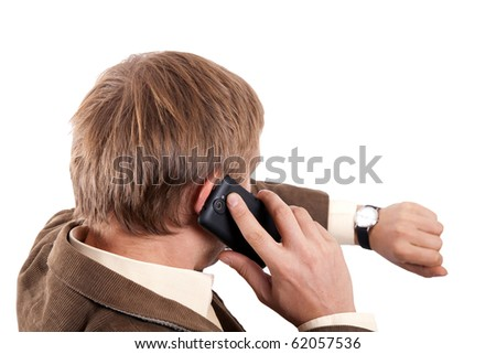 Man with cellphone from back - stock photo
