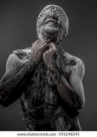 man with chains and blindfolded concept of prison, without freedom - stock photo