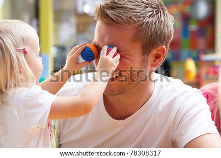 Man with children playing together - stock photo