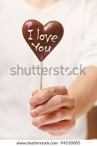 man with chocolate heart in the hands - stock photo