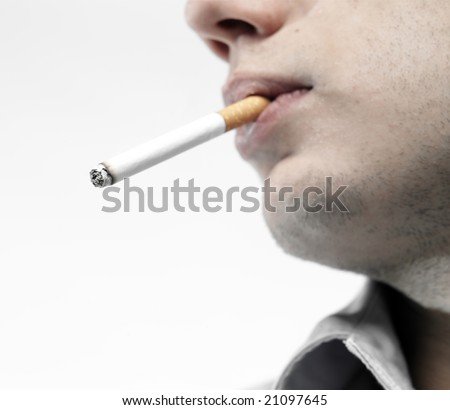 man with cigarette in mouth - stock photo