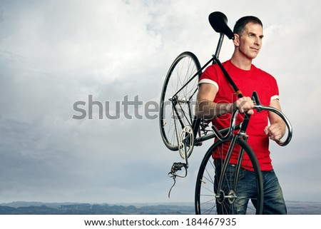 man with classic fixed gear bicycle - stock photo