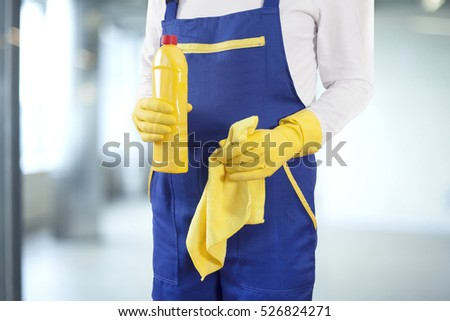 Man with cleaning supplies in building