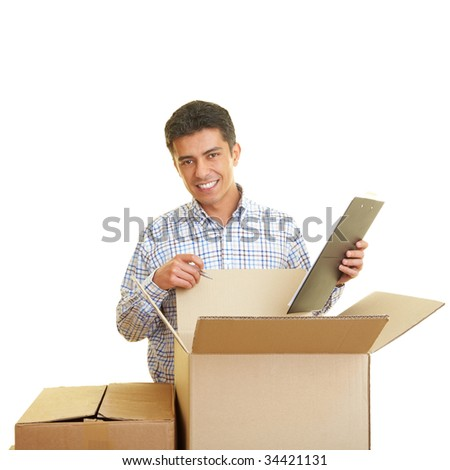Man with clipboard counting cardboard boxes - stock photo