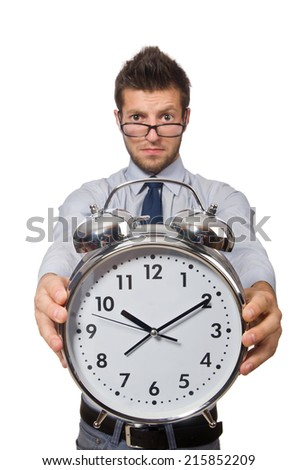 Man with clock trying to meet the deadline isolated on white - stock photo