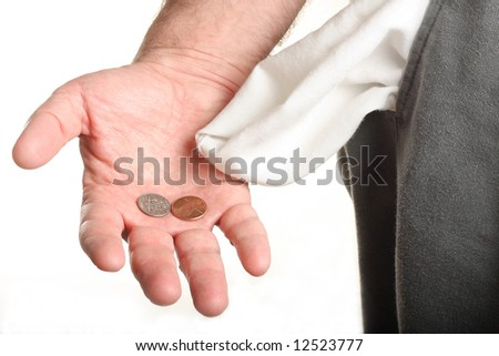 Man with coins in palm and empty pocket - stock photo