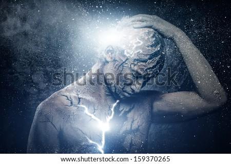 Man with conceptual spiritual body art - stock photo
