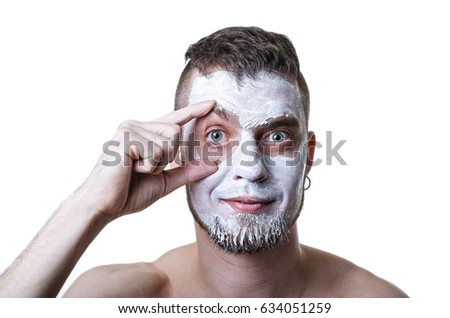 Man with cosmetic mask on face, portrait isolated on white. Beauty salon, face care.