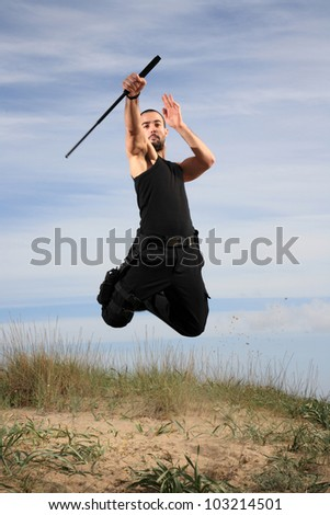 man with crowbar  in the air - stock photo