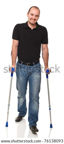 man with crutch isolated on white background - stock photo