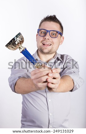 man with cup of victory