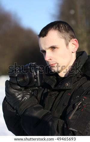 Man with Digital Photo Camera - stock photo