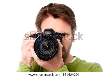Man with digital SLR camera isolated over white - stock photo