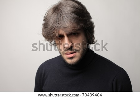 Man with disappointed expression - stock photo