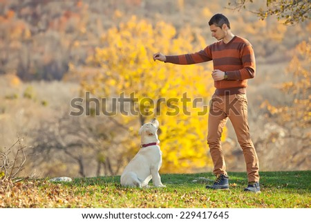 Man with dog - stock photo