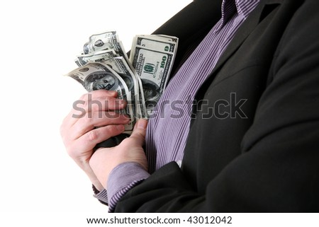man with dollars in pocket. male getting money out of suit to pay - stock photo
