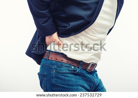 Man with dorsal pain - stock photo