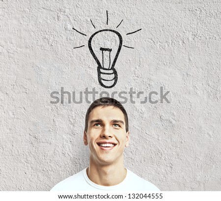 man with drawing lamp, idea concept - stock photo