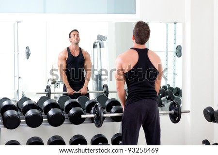 man with dumbbell weight training equipment on sport gym - stock photo