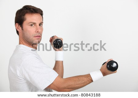 man with dumbbells - stock photo