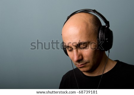 Man with ear-phones. Intimate portrait. - stock photo