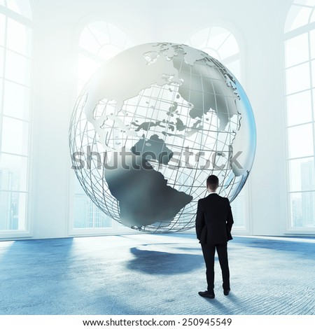 Man with earth globe concept - stock photo