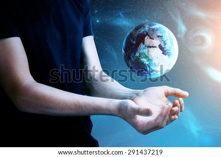 man with earth on space background - stock photo