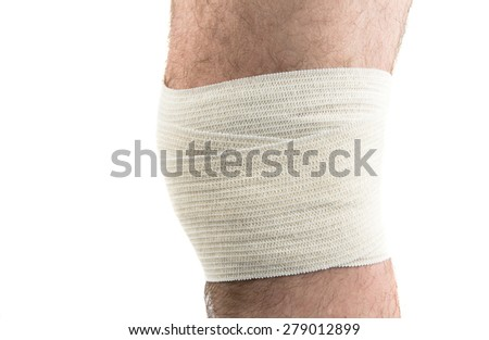 man with elastic bandage on knee, isolated on white