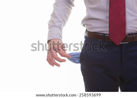 man with empty pockets for recession, bankrupt, or crisis - stock photo