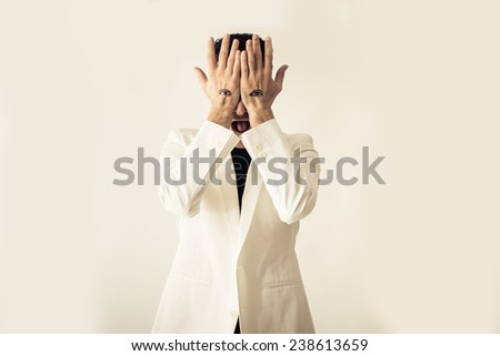 man with eyes over hands. conceptual image with different messages - stock photo