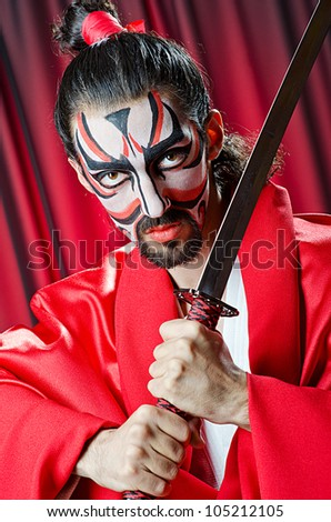 Man with face mask and sword